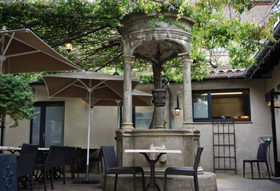 Old well in a courtyard restaurant